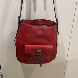 TUMI red leather shoulder bag